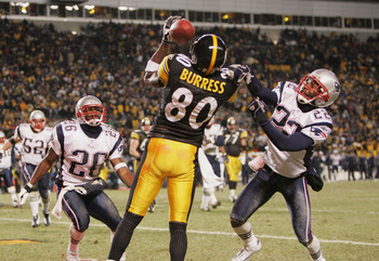 PITTSBURGH - JANUARY 23:   Wide receiver Plaxico Burress #80 of the Pittsburgh Steelers can't hang on to a pass while being defended by defensive backs Eugene Wilson #26 and Asante Samuel #22 of the New England Patriots in the AFC championship game at Hei