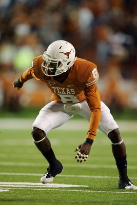 AUSTIN, TX - OCTOBER 10:  Cornerback Chykie Brown #8 of the Texas Longhorns launches off the snap against the Colorado Buffaloes on October 10, 2009 at Darrell K Royal-Texas Memorial Stadium in Austin, Texas.  Texas won 38-14.  (Photo by Brian Bahr/Getty