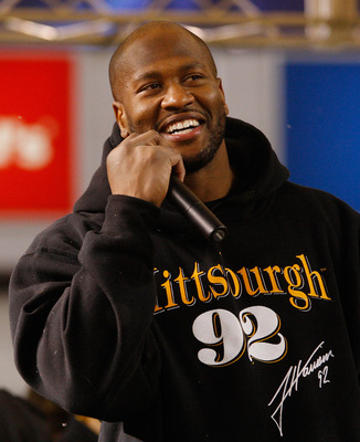 PITTSBURGH - JANUARY 28:  James Harrison #92 of the Pittsburgh Steelers talks to fans during the Super Bowl XLV Pep Rally on January 28, 2011 at Heinz Field in Pittsburgh, Pennsylvania.  (Photo by Jared Wickerham/Getty Images)