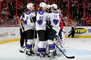 WASHINGTON, DC - FEBRUARY 12:  Michal Handzus #26 of the Los Angeles Kings celebrates with teammates after scoring in the thrid period against the Washington Capitals at the Verizon Center on February 12, 2011 in Washington, DC.  The Kings won the game 4-