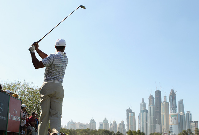 DUBAI, UNITED ARAB EMIRATES - FEBRUARY 12:  Tiger Woods of the USA in action during the third round for the 2011 Omega Dubai desert Classic held on the Majilis Course at the Emirates Golf Club on February 12, 2011 in Dubai, United Arab Emirates.  (Photo b