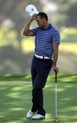 LA JOLLA, CA - JANUARY 26:  Tiger Woods scratches his head as he wait for a putt during the Pro-Am at the Farmers Insurance Open at Torrey Pines on January 26, 2011 in La Jolla, California. (Photo by Donald Miralle/Getty Images)