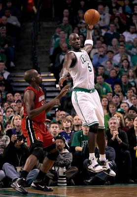 BOSTON - FEBRUARY 13:  Kevin Garnett #5 of the Boston Celtics catches a pass against Joel Anthony #50 of the Miami Heat at TD Garden on February 13, 2011 in Boston, Massachusetts. The Celtics won 85-82. NOTE TO USER: User expressly acknowledges and agrees