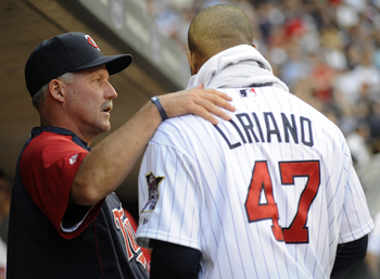MINNEAPOLIS, MN - MAY 26: Pitching coach Rick Anderson #40 and Francisco Liriano #47 of the Minnesota Twins speak in the dugout after Liriano pitched seven complete innings against the New York Yankees during their game on May 26, 2010 at Target Field in