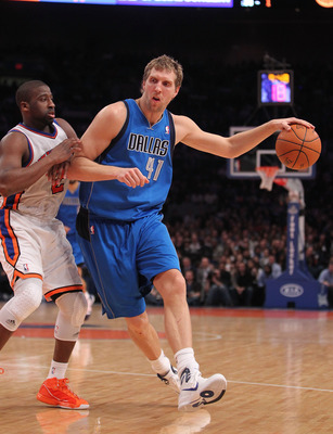 NEW YORK, NY - FEBRUARY 02:  Dirk Nowitzki #41 of the Dallas Mavericks drives the ball against Raymond Felton #2 of the New York Knicks at Madison Square Garden on February 2, 2011 in New York City. NOTE TO USER: User expressly acknowledges and agrees tha