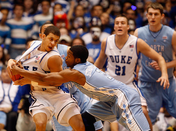 DURHAM, NC - FEBRUARY 09:  Dexter Strickland #1 of the North Carolina Tar Heels tries to steal the ball away from Seth Curry #30 of the Duke Blue Devils during their game at Cameron Indoor Stadium on February 9, 2011 in Durham, North Carolina.  (Photo by