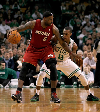 BOSTON - FEBRUARY 13:  LeBron James #6 of the Miami Heat battles Rajon Rondo #9 of the Boston Celtics ffor control of the ball at TD Garden on February 13, 2011 in Boston, Massachusetts. NOTE TO USER: User expressly acknowledges and agrees that, by downlo