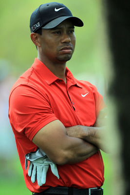 DUBAI, UNITED ARAB EMIRATES - FEBRUARY 13:  Tiger Woods of the USA waits to play his second shot at the par 4, 1st hole during the final round of the 2011 Omega Dubai Desert Classic on the Majilis Course at the Emirates Golf Club on February 13, 2011 in D