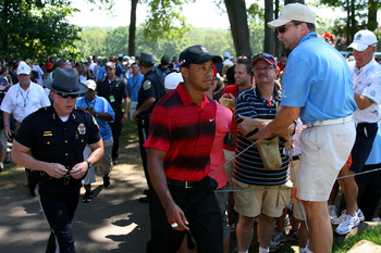 PARAMUS, NJ - AUGUST 29:  Tiger Woods walks through the gallery of fans between the fifth green and the tee box on the sixth hole during the final round of The Barclays at the Ridgewood Country Club on August 29, 2010 in Paramus, New Jersey.  (Photo by Hu