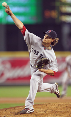 SEATTLE - SEPTEMBER 15:  Starting pitcher Clay Buchholz #11 of the Boston Red Sox pitches against the Seattle Mariners at Safeco Field on September 15, 2010 in Seattle, Washington. The Red Sox defeated the Mariners 5-1. (Photo by Otto Greule Jr/Getty Imag