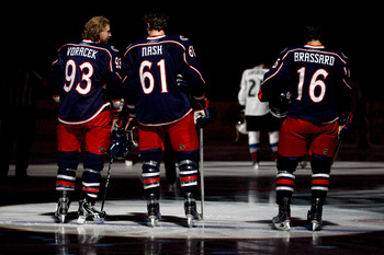 COLUMBUS, OH - FEBRUARY 11: Jakub Voracek #93, Rick Nash #61, and Derick Brassard #16, all of the Columbus Blue Jackets stand during the National Anthem prior to the start of the game against the Colorado Avalanche on February 11, 2011 at Nationwide Arena