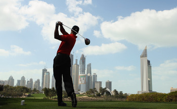 DUBAI, UNITED ARAB EMIRATES - FEBRUARY 13:  Tiger Woods of the USA in action during the final round for the 2011 Omega Dubai desert Classic held on the Majilis Course at the Emirates Golf Club on February 13, 2011 in Dubai, United Arab Emirates.  (Photo b