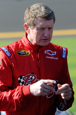 DAYTONA BEACH, FL - FEBRUARY 13:  Bill Elliott, driver of the #09 Phoenix Construction Chevrolet, stands on the grid during qualifying for the NASCAR Sprint Cup Series Daytona 500 at Daytona International Speedway on February 13, 2011 in Daytona Beach, Fl