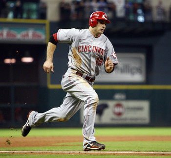 HOUSTON - SEPTEMBER 19:  Joey Votto #19 of the Cincinnatti Reds scores in the eighth inning against the Houston Astros on a single by Jay Bruce at Minute Maid  Park on September 19, 2010 in Houston, Texas.  (Photo by Bob Levey/Getty Images)