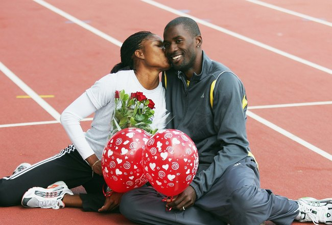 MELBOURNE, AUSTRALIA - FEBRUARY 14:  Caribbean athletes and husband and wife, Cydonie Mothersill (L) and Ato Modibo, pose for a Valentines day photo during a training session February 14, 2006 in Melbourne, Australia. (Photo by Sean Garnsworthy/Getty Imag