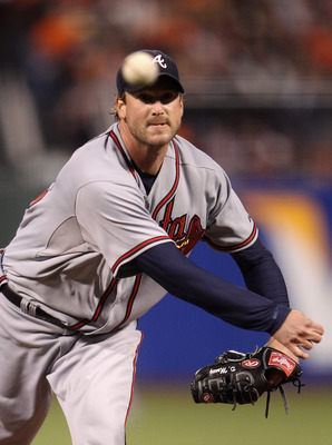 SAN FRANCISCO - OCTOBER 07:  Derek Lowe #32 of the Atlanta Braves pitches against the San Francisco Giants during game 1 of the NLDS at AT&T Park on October 7, 2010 in San Francisco, California.  (Photo by Ezra Shaw/Getty Images)