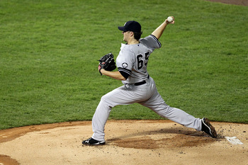 ARLINGTON, TX - OCTOBER 22:  Phil Hughes #65 of the New York Yankees throws a pitch against the Texas Rangers in Game Six of the ALCS during the 2010 MLB Playoffs at Rangers Ballpark in Arlington on October 22, 2010 in Arlington, Texas.  (Photo by Ronald