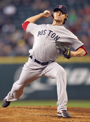 SEATTLE - SEPTEMBER 15:  Starting pitcher Clay Buchholz #11 of the Boston Red Sox pitches against the Seattle Mariners at Safeco Field on September 15, 2010 in Seattle, Washington. (Photo by Otto Greule Jr/Getty Images)