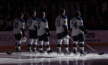 SUNRISE, FL - FEBRUARY 8: The St. Louis Blues line up on the blue line for the national anthem prior to the NHL game against the Florida Panthers on February 8, 2011 at the BankAtlantic Center in Sunrise, Florida. The Blues defeated the Panthers 2-1. (Pho
