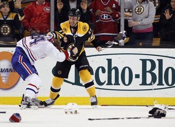 BOSTON, MA - FEBRUARY 09:  Gregory Campbell #11 of the Boston Bruins and Tom Pyatt #94 of the Montreal Canadiens fight in the third period on February 9, 2011 at the TD Garden in Boston, Massachusetts. The Bruins defeated the Canadiens 8-6.  (Photo by Els