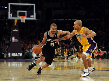 LOS ANGELES, CA - FEBRUARY 03:  Tony Parker #9 of the San Antonio Spurs dribbles to the basket as he is guarded by Derek Fisher #2 of the Los Angeles Lakers at Staples Center on February 3, 2011 in Los Angeles, California.  NOTE TO USER: User expressly ac