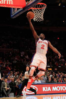 NEW YORK, NY - JANUARY 24: Raymond Felton #2 of the New York Knicks lays the ball up against the Washington Wizard at Madison Square Garden on January 24, 2011 in New York City. NOTE TO USER: User expressly acknowledges and agrees that, by downloading and