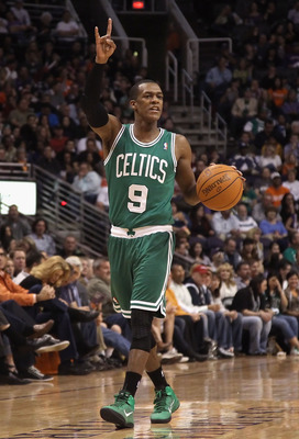 PHOENIX, AZ - JANUARY 28:  Rajon Rondo #9 of the Boston Celtics handles the ball during the NBA game against the Phoenix Suns at US Airways Center on January 28, 2011 in Phoenix, Arizona.  The Suns defeated the Celtics 88-71.  NOTE TO USER: User expressly