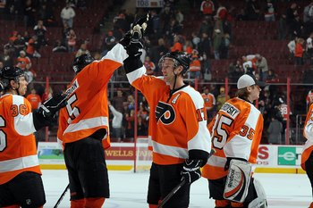 PHILADELPHIA, PA - FEBRUARY 05:  Jeff Carter #17 and Braydon Coburn #5 of the Philadelphia Flyers celebrate against the Dallas Stars on February 5, 2011 at Wells Fargo Center in Philadelphia, Pennsylvania. The Flyers defeated the Stars 3-1.  (Photo by Jim