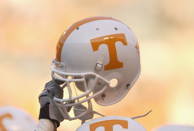 KNOXVILLE, TN - SEPTEMBER 7:  A Tennessee Volunteer holds up his helmet in the team huddle before the NCAA football game against the Middle Tennessee State Blue Raiders at Neyland Stadium on September 7, 2002 in Knoxville, Tennessee. Tennessee won 26-3. (