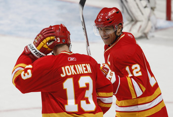 CALGARY, CANADA - FEBRUARY 9: Jarome Iginla #12 of the Calgary Flames celebrates with Olli Jokinen #13 following Olli's goal against the  Ottawa Senators in second period action at Scotiabank Saddledome February 9, 2011 in Calgary, Alberta, Canada. (Photo