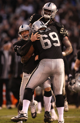 OAKLAND, CA - NOVEMBER 07: Sebastian Janikowski #11 of the Oakland Raiders celebrates with Jared Veldheer #29 and Lamarr Houston #99 after kicking the game winning field goal in overtime against the Kansas City Chiefs during an NFL game at Oakland-Alameda
