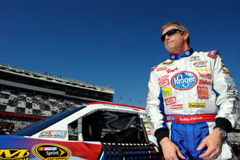 DAYTONA BEACH, FL - FEBRUARY 13:  Bobby Labonte, driver of the #47 Kroger/USO Toyota, stands on the grid during qualifying for the NASCAR Sprint Cup Series Daytona 500 at Daytona International Speedway on February 13, 2011 in Daytona Beach, Florida.  (Pho