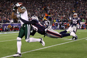 FOXBORO, MA - JANUARY 16:  Braylon Edwards #17 of the New York Jets catches a pass over Darius Butler #28 of the New England Patriots during their 2011 AFC divisional playoff game at Gillette Stadium on January 16, 2011 in Foxboro, Massachusetts.  (Photo