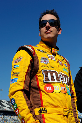 DAYTONA BEACH, FL - FEBRUARY 13:  Kyle Busch, driver of the #18 M&M's Toyota, stands on the grid during qualifying for the NASCAR Sprint Cup Series Daytona 500 at Daytona International Speedway on February 13, 2011 in Daytona Beach, Florida.  (Photo by Ja
