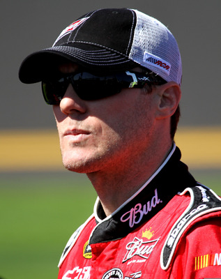 DAYTONA BEACH, FL - FEBRUARY 13:  Kevin Harvick, driver of the #29 Budweiser Chevrolet, stands on the grid during qualifying for the NASCAR Sprint Cup Series Daytona 500 at Daytona International Speedway on February 13, 2011 in Daytona Beach, Florida.  (P