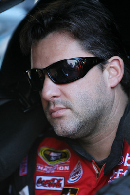 DAYTONA BEACH, FL - FEBRUARY 12:  Tony Stewart, driver of the #14 Mobil 1/Office Depot Chevrolet, sits in his car during practice for the NASCAR Sprint Cup Series Daytona 500 at Daytona International Speedway on February 12, 2011 in Daytona Beach, Florida