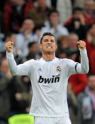 MADRID, SPAIN - FEBRUARY 06:  Cristiano Ronaldo of Real Madrid celebrates after scoring Real's third goal during the La Liga match between Real Madrid and Real Sociedad at Estadio Santiago Bernabeu on February 6, 2011 in Madrid, Spain.  (Photo by Denis Do