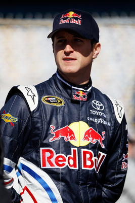 DAYTONA BEACH, FL - FEBRUARY 12:  Kasey Kahne, driver of the #4 Red Bull Toyota, stands in the garage area during practice for the NASCAR Sprint Cup Series Daytona 500 at Daytona International Speedway on February 12, 2011 in Daytona Beach, Florida.  (Pho