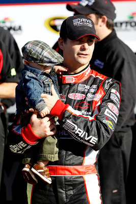 DAYTONA BEACH, FL - FEBRUARY 13:  Front Row award winner Jeff Gordon, driver of the #24 Drive to End Hunger Chevrolet, poses with his son Leo Gordon in victory lane after qualifying for the NASCAR Sprint Cup Series Daytona 500 at Daytona International Spe