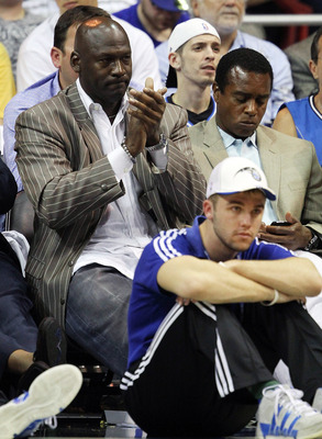 ORLANDO, FL - APRIL 18:  Owner Michael Jordan of the Charlotte Bobcats sits next to former NFL player Ahmad Rashad while watching his team take on the Orlando Magic in Game One of the Eastern Conference Quarterfinals during the 2010 NBA Playoffs at Amway