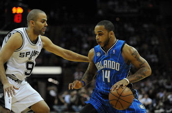 SAN ANTONIO - JANUARY 11:  Guard Jameer Nelson #14 of the Orlando Magic dribbles the ball against Tony Parker #9 of the San Antonio Spurs on January 11, 2009 at AT&amp;T Center in San Antonio, Texas.  NOTE TO USER: User expressly acknowledges and agrees that,