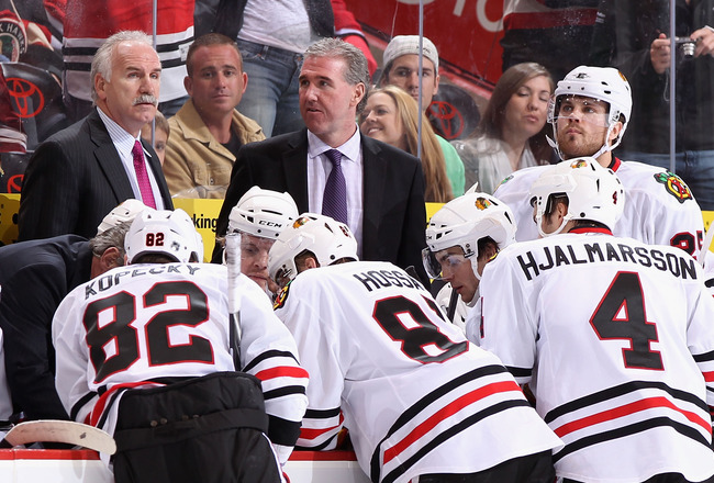 GLENDALE, AZ - FEBRUARY 12:  Head coach Joel Quenneville of the Chicago Blackhawks talks with his team during a time out from the NHL game against the Phoenix Coyotes at Jobing.com Arena on February 12, 2011 in Glendale, Arizona. The Coyotes defeated the