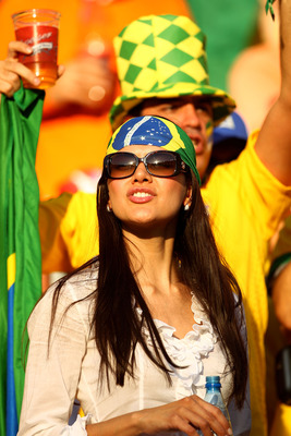 PORT ELIZABETH, SOUTH AFRICA - JULY 02:  A Brazil fan enjoys the atmosphere prior to the 2010 FIFA World Cup South Africa Quarter Final match between Netherlands and Brazil at Nelson Mandela Bay Stadium on July 2, 2010 in Nelson Mandela Bay/Port Elizabeth