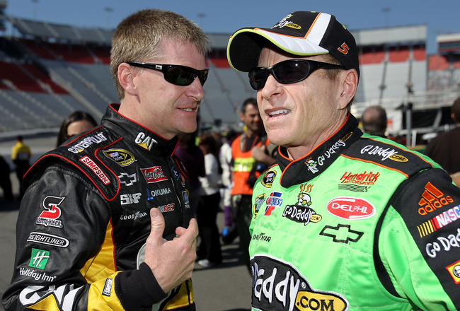 BRISTOL, TN - MARCH 19:  Jeff Burton (L), driver of the #31 Caterpillar Chevrolet, talks with Mark Martin, driver of the #5 GoDaddy.com Chevrolet, in the garage area  after qualifying for the NASCAR Sprint Cup Series Food City 500 at Bristol Motor Speedwa