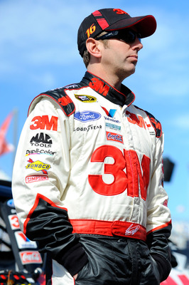 DAYTONA BEACH, FL - FEBRUARY 12:  Greg Biffle, driver of the #16 3M Ford, stands in the garage area during practice for the NASCAR Sprint Cup Series Daytona 500 at Daytona International Speedway on February 12, 2011 in Daytona Beach, Florida.  (Photo by J