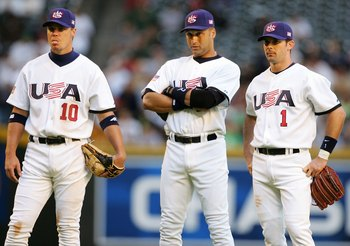 PHOENIX - MARCH 08:  Infielders Chipper Jones #10, Derrek Jeter #2 and Michael Young #1 of Team USA look on during a pitching change from the Round 1 Pool B Game of the World Baseball Classic against Team Canada on March 8, 2006 at Chase Field in Phoenix,