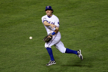ARLINGTON, TX - NOVEMBER 01:  Ian Kinsler #5 of the Texas Rangers throws the ball to first base against the San Francisco Giants in Game Five of the 2010 MLB World Series at Rangers Ballpark in Arlington on November 1, 2010 in Arlington, Texas.  (Photo by