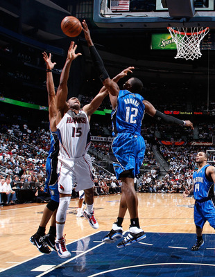ATLANTA - MAY 10:  Dwight Howard #12 of the Orlando Magic blocks a shot by Al Horford #15 of the Atlanta Hawks during Game Four of the Eastern Conference Semifinals of the 2010 NBA Playoffs at Philips Arena on May 10, 2010 in Atlanta, Georgia.  NOTE TO US