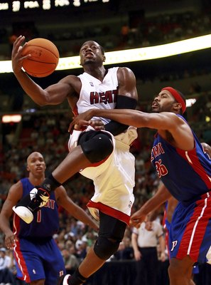 MIAMI - NOVEMBER 30:  Rasheed Wallace #36 of the Detroit Pistons fouls Dwyane Wade #3 of the Miami Heat at American Airlines Arena on November 30, 2006 in Miami, Florida. The Pistons defeated the Heat 87-85. NOTE TO USER: User expressly acknowledges and a