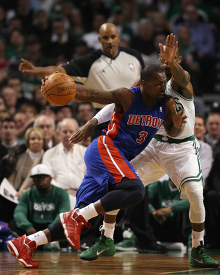 BOSTON, MA - JANUARY 19:  Rodney Stuckey #3 of the Detroit Pistons drives to the net as Rajon Rondo #9 of the Boston Celtics defends on January 19, 2011 at the TD Garden in Boston, Massachusetts.  NOTE TO USER: User expressly acknowledges and agrees that,